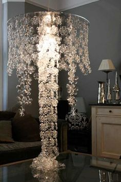 chandelier made entirely from cut-off 2-liter bottle bases.  The plastic bases resemble flowers, and strung from a metal hoop with fishing wire, they make a surprisingly lovely chandelier.