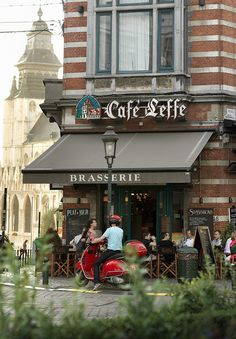 Cafe Leffe, Brussels....In Belgium...they hold the beer glass to your cheek and say ...to your face...not cheers...but meaning...health happiness...