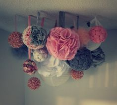 Tutorial for this fun multipurpose pink and grey DIY POM POM chandelier/mobile! Perfect for a baby's room, bridal shower, baby shower or wedding!
