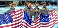 United States' Michael Phelps, Conor Dwyer,Ricky Berens and  Ryan Lochte pose with their gold medals for the men's 4x200-meter freestyle relay