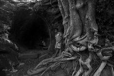 local children exploring the caves, Medirigiriya