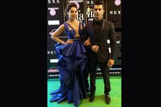 After picking a light shade traditional look, Bipasha went all suave with a blue Jani Khosla dress. The actress looked every inch glamorous as she walked the green carpet alongside her husband Karan Singh Grover. #IIFA2016