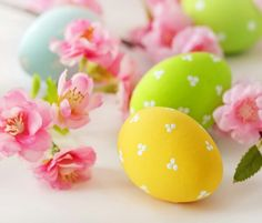 Little easter eggs with tiny dots and pink flowers easter