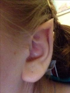 DIY Elf Ears! Take scotch tape and wrap around top of ear, pinching into a point. Cut a slit the middle section of the tape and tuck into the sides of that into the pinched ear. Take liquid concealer and spread on tape and ear to balance the color tone. Put a powder concealer over that to even the tone. Takes some practice, but there ya have it! Learned it on a YouTube video