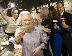 Lookalikes of the Queen, the Duke and Duchess of Cambridge, Prince Charles and Camilla have been captured enjoying a coffee break by the famed photographer - and even pose for a selfie taken by the Queen
