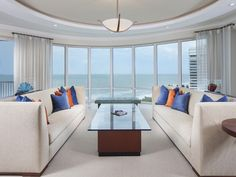 Living Room with an ocean View   floor to ceiling windows over the Gulf of Mexico - Regent Park Shore - Melinda Gunther Naples Realtor
