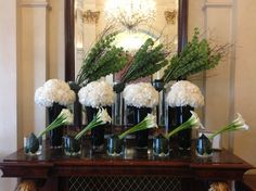 This weeks lobby flower display. White hydrangea, white calla lilies and green bells of Ireland mixed with birch