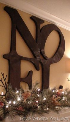 Bronzed, purchased @ Pottery Barn, but could easily be made with letters from Hobby Lobby or Michaels.