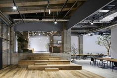 Multiple levels and trees inside, exposed services  AKQA Tokyo Office by Torafu Architects   Yellowtrace