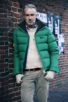 Shop this look on Lookastic: http://lookastic.com/men/looks/crew-neck-t-shirt-long-sleeve-shirt-crew-neck-sweater-puffer-jacket-belt-gloves-jeans/9221 — White Crew-neck T-shirt — White and Red and Navy Plaid Long Sleeve Shirt — Beige Crew-neck Sweater — Green Puffer Jacket — Dark Brown Leather Belt — Grey Wool Gloves — Grey Jeans
