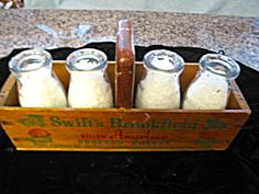 Vintage milk bottles and chesse box carrier sold at More Than McCoy on TIAS at www.morethanmccoy.com