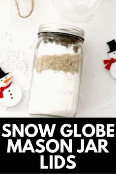Turn your hoards of mason jars into holly jolly Christmas decor with our DIY Snow GLobe Mason Jar Lids tutorial! Get the full tutorial at MomDot.com!