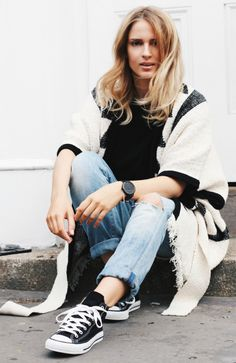 Converse + perfect footwear choice + Mirjam Flatau + destroyed black tee + oversized distressed denim + aztec style poncho    Poncho: Edited, Jeans/Tee: Citezens Of Humanity, Shoes: Converse.