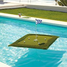 practice your short game with this floating golf green. this turf set comes with floating golf balls, flag and tee box.