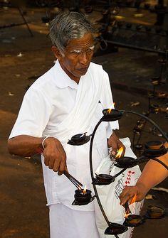 Man lighting coconut oil candles, Anuradhapura, Sri Lanka Sri Lanka, Traveling By Yourself, Oil Candles, Trotter, Coconut Oil, Globe, Asia, Lighting, Speech Balloon