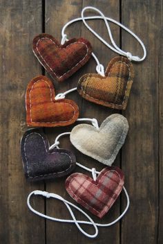 Flannel rustic hearts. Cute idea for a cozy themed Christmas tree with strings of cranberries, popcorn, white lights, and wooden ornaments.