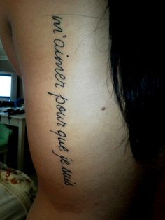 """No idea what part of the body this is but the quote is good. """"m'aimer pour que je suis"""" - """"love me for who I am"""" in French. My 2nd (and favorite) tattoo! Got this text tat down my back, but high enough to show in dresses. LOVE!"""