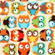 beige designer owl fabric with small colourful owls
