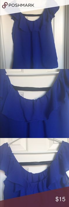 Beautiful blue Charlotte Russe blouse Beautiful royal blue shirt ruffled at the top in the front and back, with a black elastic strip on the back going across that gives it a unique look. In great condition. Charlotte Russe Tops Blouses