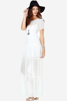 Steal the show in the ultimate boho dress that's equal parts sexy and classic.  It's  made in a s...