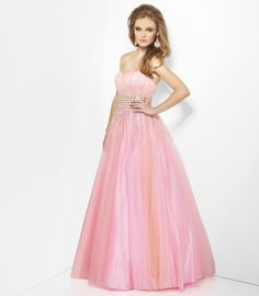 Shimmering strapless net gown with corset lace-up detail in back.  Discreet sweetheart neckline and wide sequined belt provide flattering final touches for this classic prom dress.