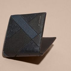 BURBERRY OSTRICH LEATHER PATCHWORK FOLDING WALLET. #burberry #