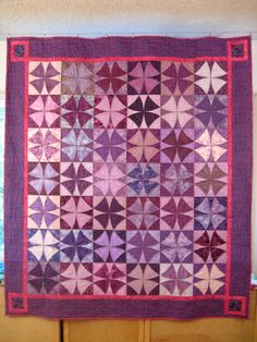 Winding Ways Quilt in purple made by Mel Beach.  To learn more, please visit http://pieceloveandhappiness.blogspot.com/2012/04/winding-ways-wrap-up.html