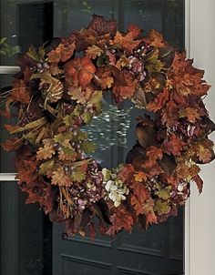 Welcome the fall harvest by bringing maize yellow, burnt orange and balmy green to your door with our Autumn Splendor Wreath.