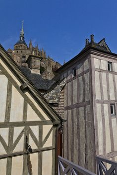 Mont Saint Michel, Normandy, France - half-timbered medieval houses. From the 12th century onwards the timbered framework of houses was raised on foundation beams that from the 13th century onwards - were additionally fitted onto stone plinth walls.