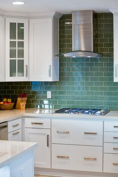Neither Bright Or Pastel The Olive Green Subway Tile Backsplash In This Kitchen Designed By Ryan Christenson Of Remodel Works Bath And Is Unusual