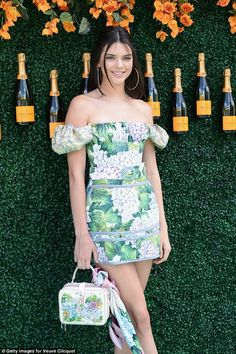 Gorgeous: Her shoulder-length hair was worn down with a middle part and large gold hoop earrings flanked her face as she made her way own the red carpet