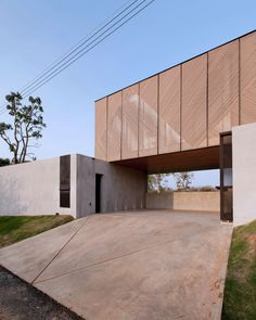 KA House is a minimalist house located in Nakhon Ratchasima, Thailand, designed by IDIN Architects.