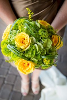 Green and yellow wedding bouquet  ~ Kelly Miranda Photography | bellethemagazine.com
