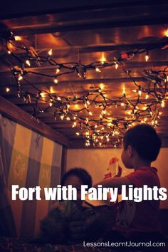 Fort with Fairy Lights: Lessons Learnt Journal; She used lights strung under the top bunk and a blanket for the entrance- so simple and so fun. :)