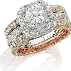 This fabulous Natalie K antique style 14k white and rose gold engagement ring set contains round brilliant cut white diamonds of G color, VS2 clarity, excellent cut and brilliance, weighing 1.54 carats total. The ring setting accommodates 1 carat round cut stone.