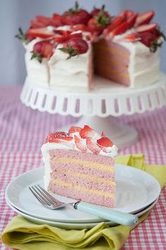 a light and tender strawberry cake with a delicious  and rich homemade lemon curd filling covered in a whipped cream cheese vanilla frosting