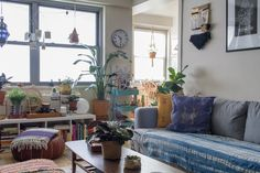 In the living room, IKEA's Karlstad sofa is topped by Sabra Silk Pillows from Collectiv Co.. The coffee table is a Lane mid-century piece from John Ricciardelli at the Brooklyn Flea (Instagram @talljohn5).