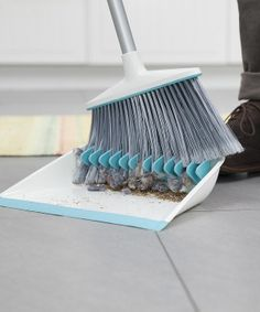 I so need this dustpan... I hate when the broom starts randomly collecting fuzzies and furrballs!