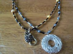 Set of two necklaces, silver tone and gold tone with black by StrungOnLove on Etsy