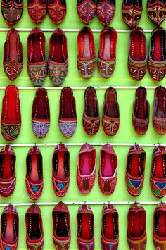 """Camel-leather shoes hang outside a shop in Hampi, India."" Smithsonian.com Photo of the Day: August 29, 2012. Photo by Kaitlin Charette."