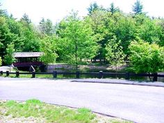 Stratton Brook State Park - Simsbury, Connecticut =  covered bridge, bikeway, hiking, cross-country skiing, ice skating, field sports, picnic, picnic shelter rental, fishing, swimming, bathrooms, seasonal interpretive displays, completely wheelchair accessible