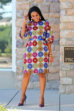 Beautiful Ankara dress, perfect with flats, sandals, and open toes heels. Dress has puffy sleeves and is loose fitting. Dress has rhinestones in the front and pockects. Fabric: AnkaraMade in Africa Nigeria Tomgfashion Ankara Collection Dress: Hip: 43 Inc African Print Dresses, African Fashion Dresses, African Attire, African Wear, African Dress, African Style, African Prints, Nigerian Fashion, African Outfits