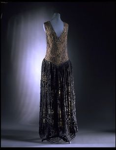 Paul Poiret. Samovar. Evening dress, 1919-1920. Rayon, embroidered with gilt strip, machine-made lace over gilt tissue and tulle. Given by Mr Vern Lambert. Museum number: T.338-1974.  Victoria & Albert Museum  © V Images