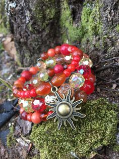 Sun Goddess: three wrap beaded memory wire bracelet with metal