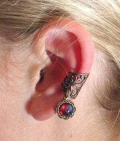 Fantasia Filigree Ear Cuff - Dragon's Breath Jeweled Earcuff by Lorelei Designs. $18.99, via Etsy.