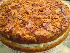 """Bienenstich, or """"bee sting cake"""" has a rich history. With origins in Germany, the cake is called """"bee sting"""" as it is thought that a bee wa. German Bee Sting Cake, German Cake, Food Cakes, Cupcake Cakes, Cupcakes, Bienenstich Cake, Just Desserts, Dessert Recipes, Dessert Thermomix"""