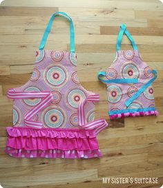 Two Aprons from a T J Maxx Shopping Bag