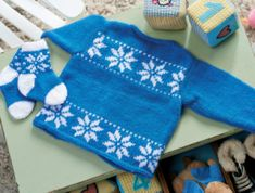 Snowflake Baby Cardigan - free knitting pattern download from Let's Knit!