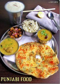 Punjabi Lunch menu - Amritsari aloo kulcha,Dal tadka,Jeera rice,Punjabi chole,Dahi kadhi & Lassi