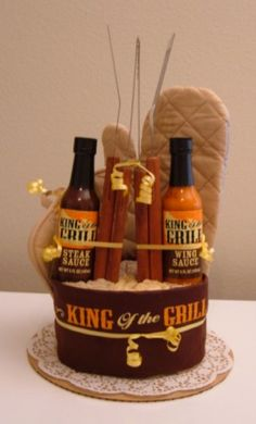 King of the Grill BBQ Kitchen Towel Cake with Apron and BBQ Tools - The Flourless Bakery Raffle Baskets, Gift Baskets, Craft Gifts, Diy Gifts, Kitchen Towel Cakes, Diaper Parties, Bbq Kitchen, Grilling Gifts, Wedding Shower Gifts